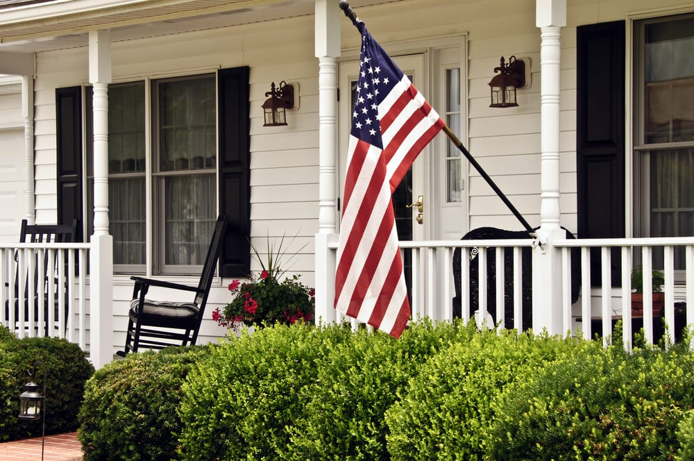 American flag hanging in front of house