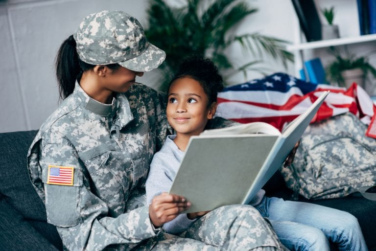 U.S. Military Mother and Daughter Reading a Book at Home